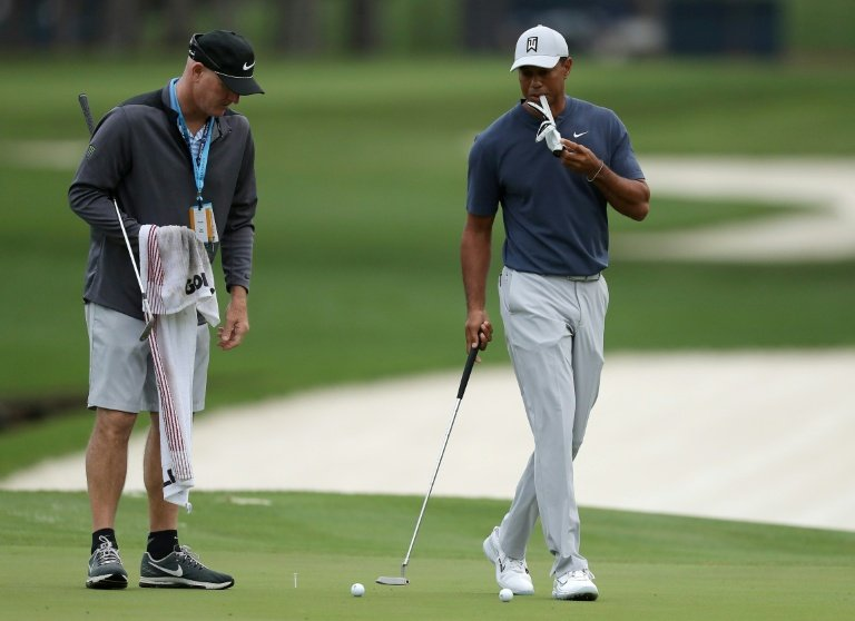 Tiger says his neck strain is no longer an issue