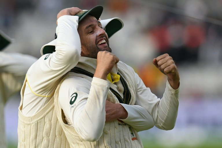 Australia make solid start on rain-interrupted opening day in Manchester