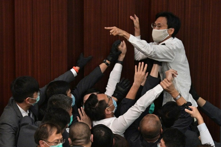 Pro-democracy and pro-Beijing lawmakers clash in Hong Kong parliament