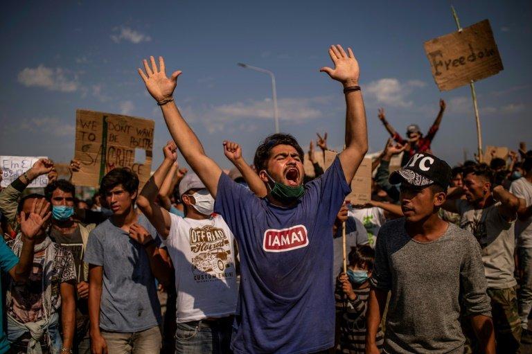 Greek migrants protest after destruction of camp leaves thousands stranded