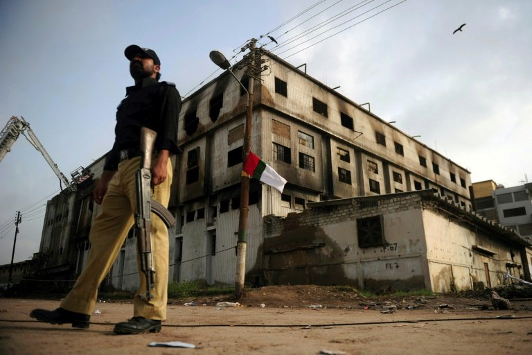 Pakistan court rules deadly 2012 blaze was arson, sentences two to death
