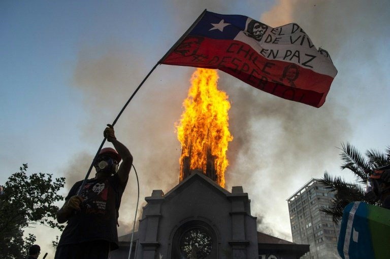 Churches burned as thousands mark Chile protest movement anniversary