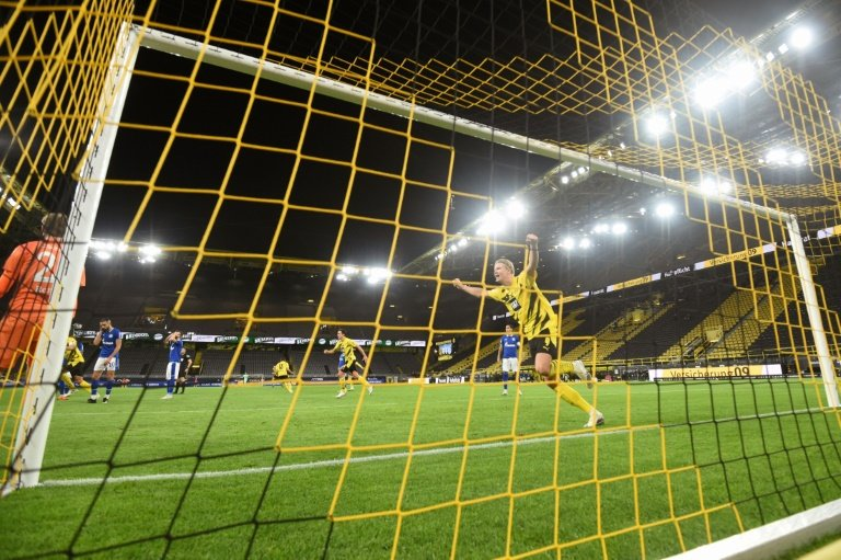 Erling Braut Haaland celebrates Dortmund's opening goal against Schalke     POOL  AFP