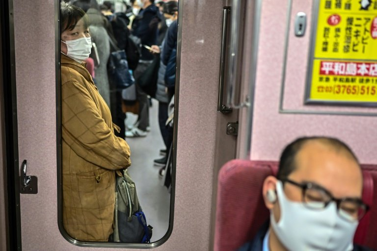 Tokyo says Covid-19 strain on hospitals severe, raises alert to highest