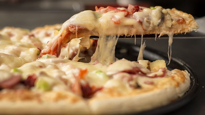 Domino's Pizza Group (LON:DOM) Stock Rating Reaffirmed by Liberum Capital